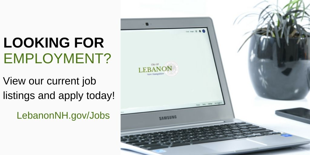 "Laptop displaying City logo and ""looking for employment?"" text"