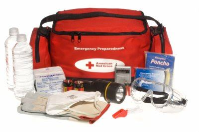 Emergency kit with water bottles, flashlight, gauze, poncho, goggles, etc.