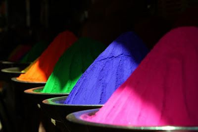 Four colored powder piles in a row